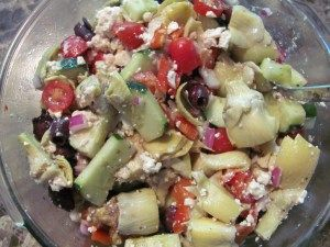 """Anti-Pasta"" Salad Approximately 4 cups frozen artichoke hearts  1/2 medium red onion, diced 1 large cucumber Approximately 2 cups of diced tomatoes, or grape tomatoes cut in half 1 cup kalamata olives, rinsed to remove some of the salt 1 red bell pepper, chopped Approximately 1/2 cup crumbled feta cheese 2-3 Tbsp olive oil 2 Tbsp apple cider vinegar Italian seasonings to taste Black pepper to taste  Mix all ingredients in a large bowl"