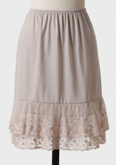 "Design it to peek out under skirts. - Antique Lace Half Slip In Taupe $28.99 Layer this taupe cotton-blend jersey slip under any skirt or dress for a modest touch and extra flounce. Finished with a scalloped, embroidered lace trim and an elastic waistband for a comfortable fit. Polyester/Cotton. 21.5""."