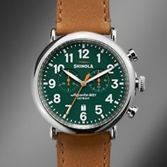 The Runwell Chrono 47mm brown leather strap chronograph watch with green dial features the Argonite 5021 quartz movement that drives the hours, minutes, small seconds, date indicator and stopwatch function with one subdial.