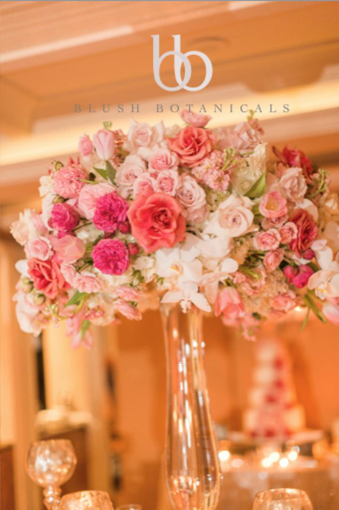 A Tall Blush Coral Pink Wedding Centerpiece At The La