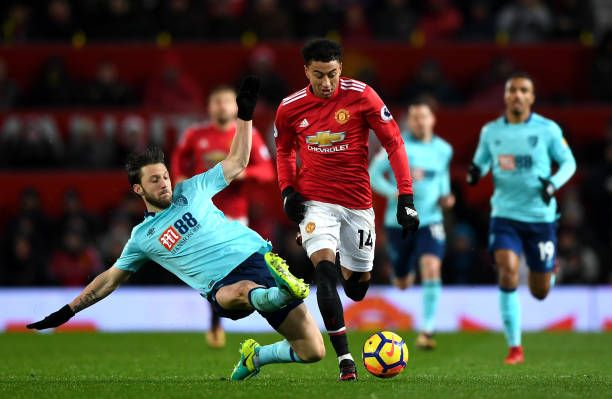 Jesse Lingard of Manchester United escapes the challenge from Harry Arter of AFC Bournemouth during the Premier League match between Manchester...