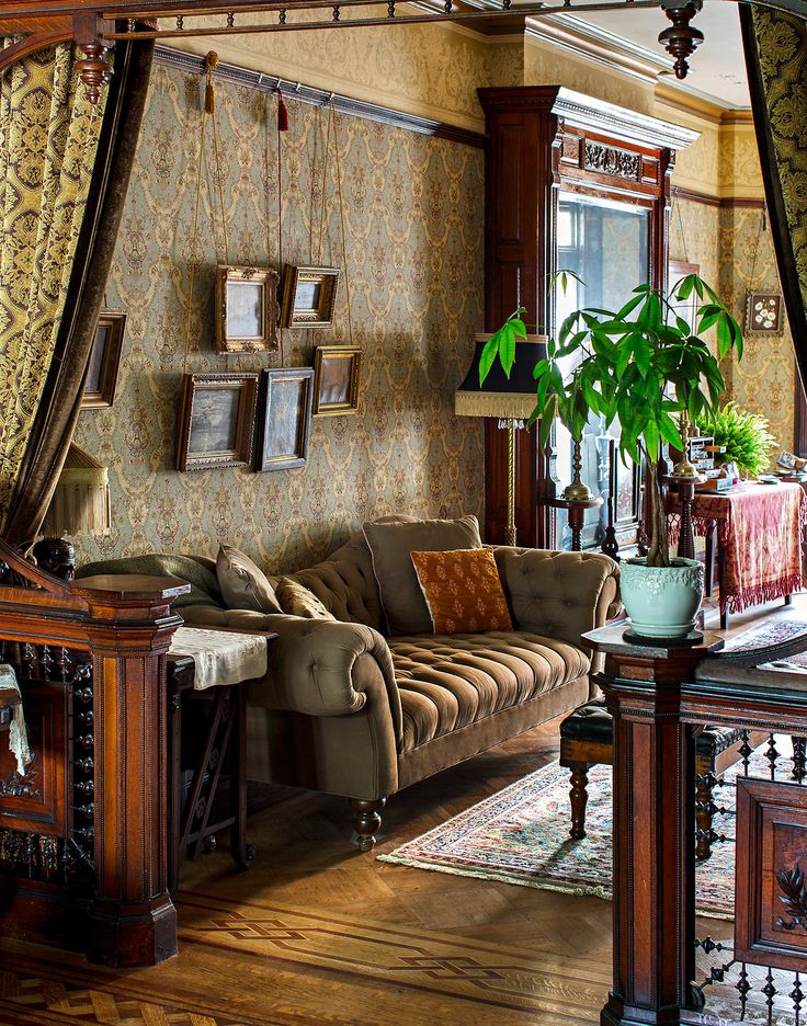 "Victoriana in Bedford-Stuyvesant - Slide Show - NYTimes.com ""Hanging on a wall in the front parlor are oil paintings that Mr. Dakota jokingly refers to as ""our collection of dreary landscapes."" The couch is from Ralph Lauren."""