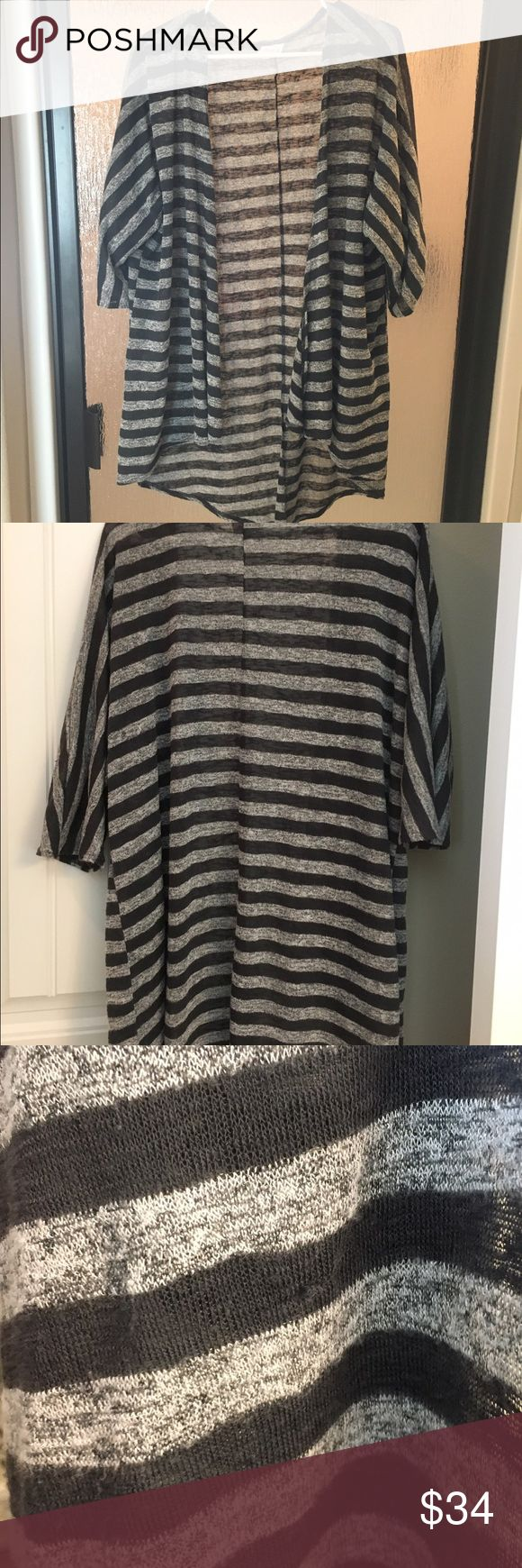 Lularoe Lindsay Lularoe Lindsay. Soft, flowy, COMFY! A couple areas where the threading is loose (shown), but you really can't tell! Bundle! Taking offers! LuLaRoe Sweaters Cardigans