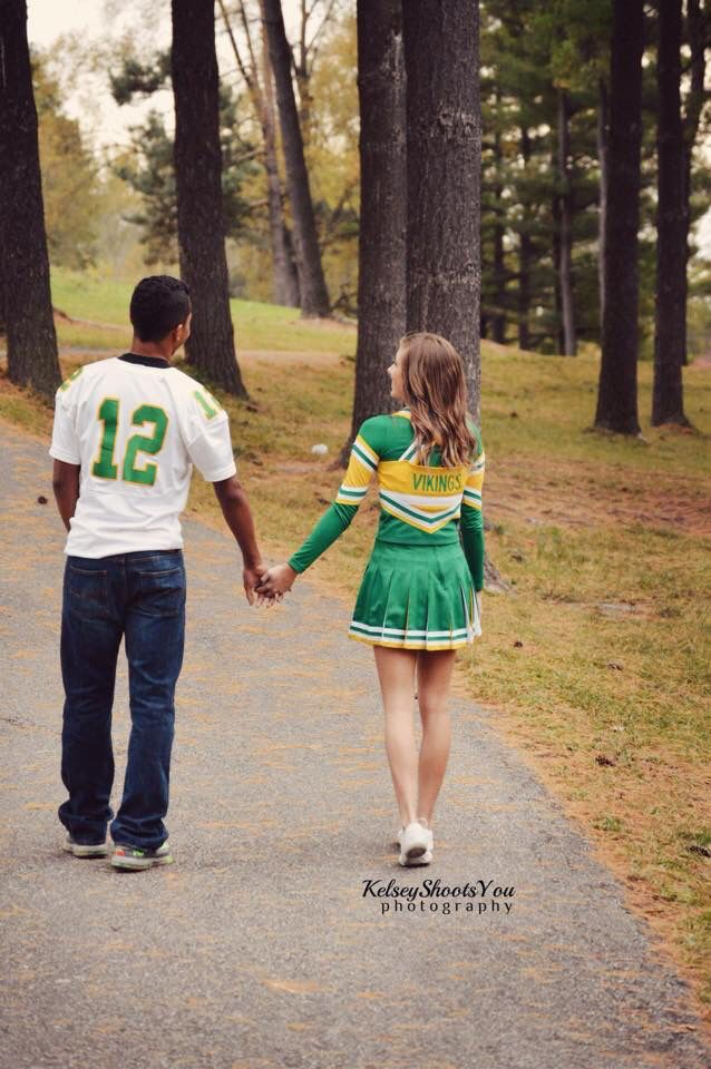 Boy. Girl. Couples. Photography. Kelseyshootsyou. Holding hands. Walking. Cheerleader. Football player. Senior pictures.
