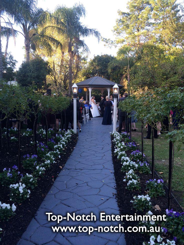 Outdoor wedding ceremony, gazebo location at Bram Leigh Receptions, Croydon, Victoria.  www.top-notch.com.au  www.facebook.com/WeddingDJTopNotch