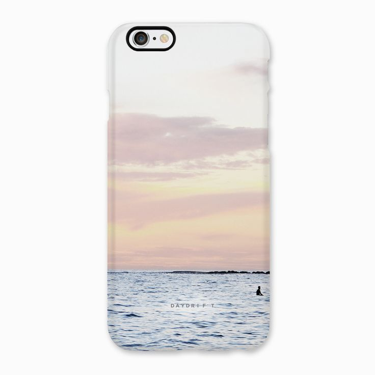 Lone surfboard rider at Coogee Beach sunrise. Limited edition luxury iPhone 5 and iPhone 6 Phone Cases featuring a Daydrift photograph of Coogee Beach Sydney Australia