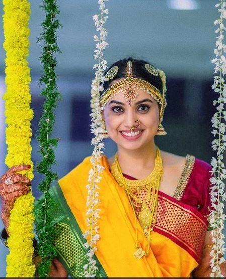 Beautiful Bride Aarthi in her Red, Yellow, and Green Nine Yard Madisar Saree