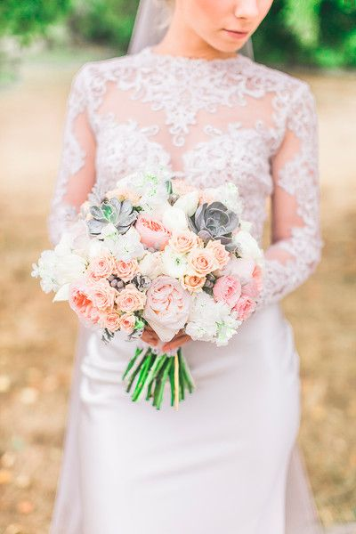 Vintage pastel wedding bouquet idea - pastel bouquet of pink garden roses, peach spray roses, stock, succulents, ivory ranunculuses, and silver brunia {Julie Bulanov Photography}