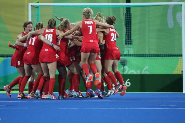 Great Britain defender Hollie Webb (20) celebrates with teammates after scoring…