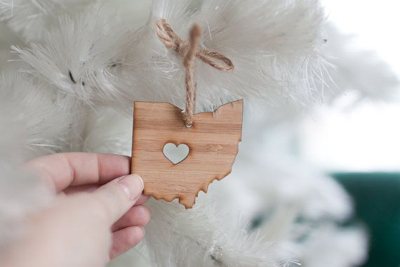 Adorable I heart Ohio ornament. Hang it on your tree, in your car or anywhere to remind you where your heart is. Made of bamboo and jute rope. Measures:
