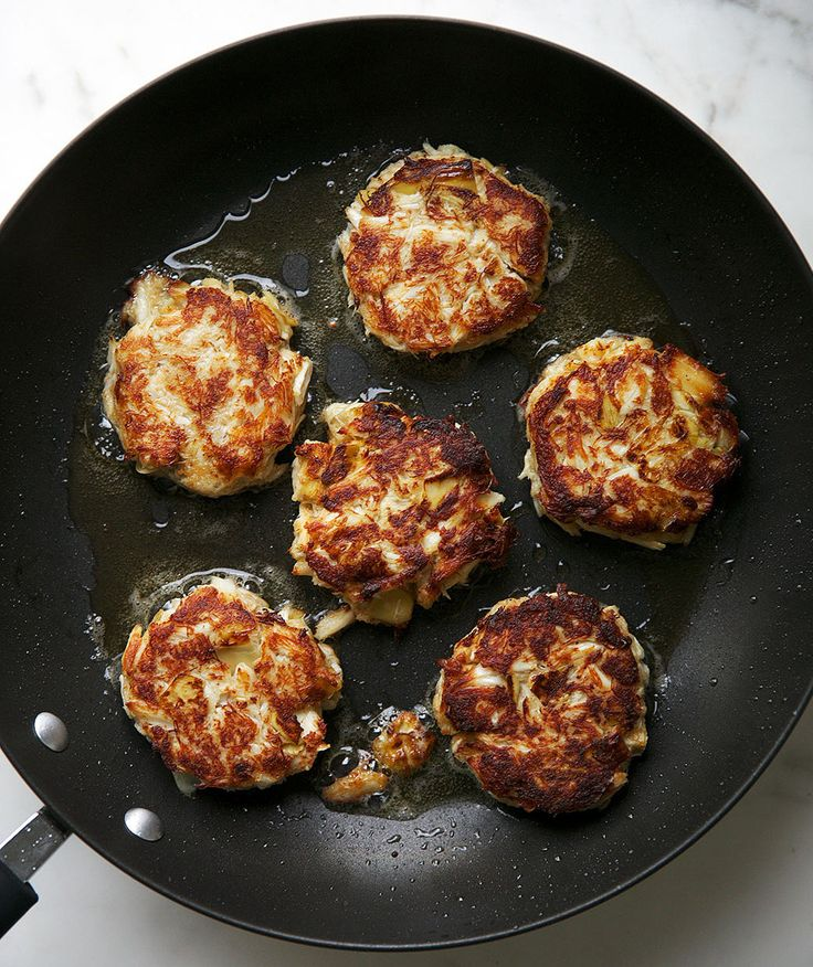 Artichoke Crab Cakes | This twist on classic crab cakes is packed with flavor thanks to the brininess of the marinated artichoke hearts. Though they work well as a main dish, you can also serve these as an appetizer—simply shape the crab mixture into miniature patties. For an added pop of color, arrange the crab cakes over a bed of greens, and top with a remoulade or salsa verde. If you'd like, make the patties ahead of time (they take minutes to whip up), and keep them refrigerated until…