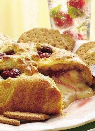Savory, flaky Crescent Rolls house this creamy brie filling. Just add raspberries and jam, and you have a lovely—and festive—holiday snack! Betty members have made it for Christmas, cookie exchange parties, and even romantic dinners. If you've never tried brie cheese before, be warned: You'll be hooked!