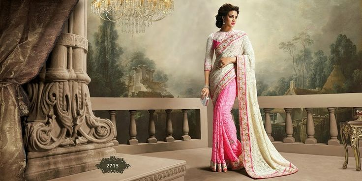 Very beautiful Wedding saree. Pink and Cream Colored Brmbergwith beautiful heavy embroidery work Pallu. Along with Contrast Matching Netted Skirt and Embroidered Silk Blouse