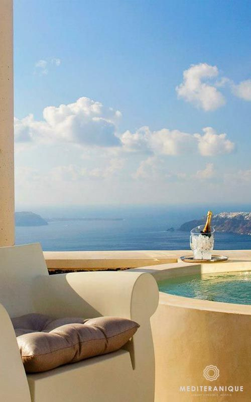 Glorious views and champagne in a private Jacuzzi at the Rocabella Santorini Deluxe Suites & Spa