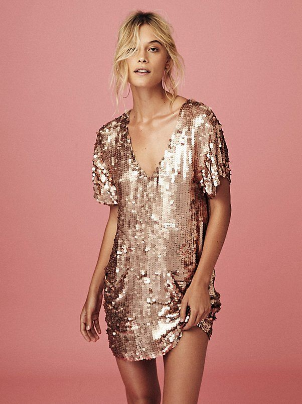 Surry Sequin Dress | Eye-catching short sleeve shift dress with large sequin embellishments allover. Two slouchy front pocket details. V-neckline with a low plunging back add a sultry touch. Fully lined.