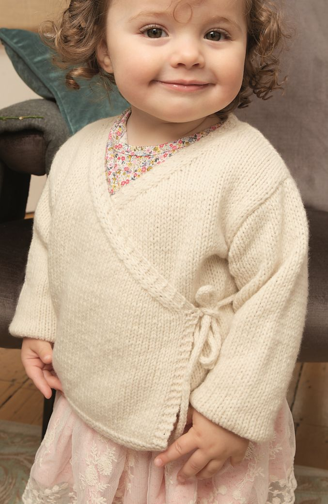Free Knitting Pattern for Snowbird Baby Cardigan - Designed by Martin Storey, this wrap sweater is knit in stockinette with side tie fastening. Sizes 0-3, 3-6, 6-9, 9-12, 12-18 months.