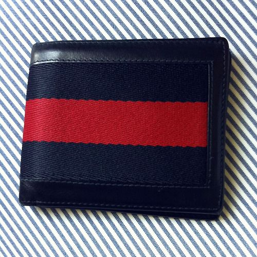 Navy Blue Gucci wallet.