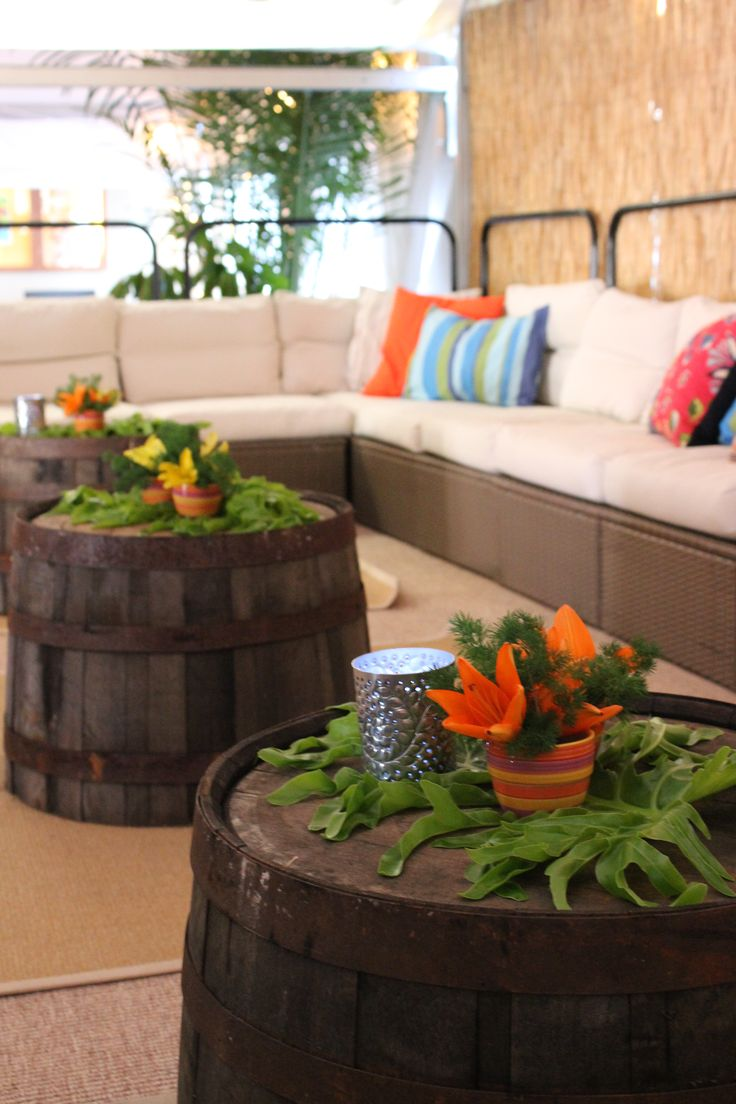 Havana nights party..awesome idea to use turned over wine barrels as tables..!