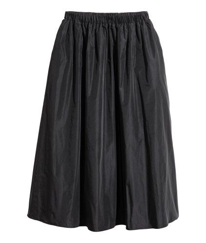 Black. Knee-length skirt in a sturdy weave with a slight sheen, with an elasticated waist and side pockets. Lined.