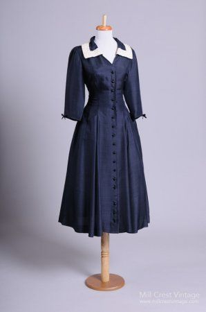 Late 1940s day dress with bracelet-length sleeves and bordered collar. Beautiful!