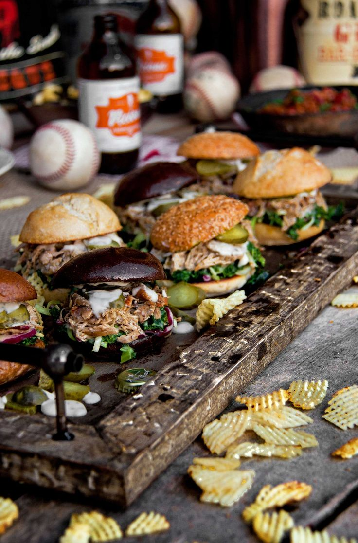 Kick off baseball opening day and knock it out of the park with this grilling recipe! Smoky Chicken Thigh Sliders with White BBQ Sauce score big!