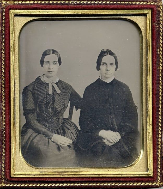 This photo released Friday, Sept. 7, 2012 by Amherst College Archives and Special Collections, and the Emily Dickinson Museum, in Amherst, Mass., shows a copy of a circa 1860 daguerreotype purported to show a 30-year-old Emily Dickinson, left, with her friend Kate Scott Turner. The image was displayed during the August, 2012 Emily Dickinson International Society conference held at at Case Western Reserve University in Cleveland.