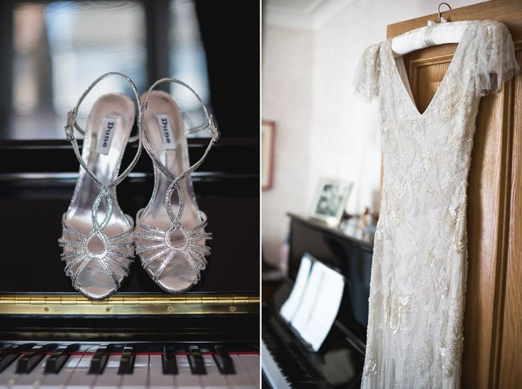 A bride wearing a beautifully beaded Eliza Jane Howell wedding dress for  her 1930's inspired wedding