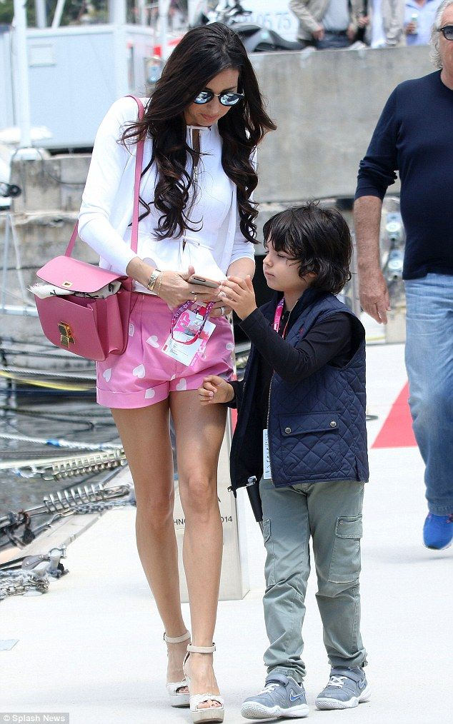 Elisabetta Gregoraci with husband Flavio Briatore - liking the pink handbag (??Celine )
