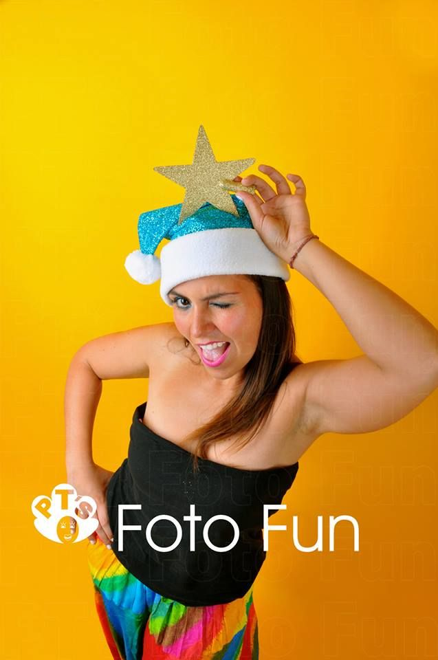 Christmas smiles, young woman with rainbow outfit, blue hat and star