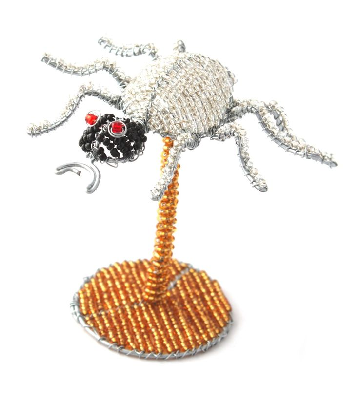 Wire beaded Beetle on a beaded stand.