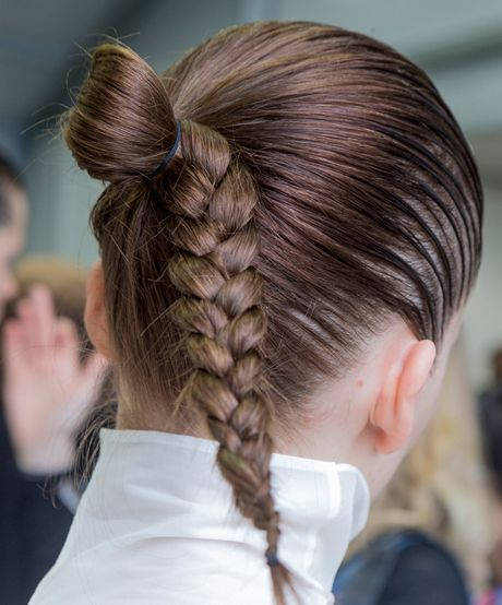 The Trend: Jil Sander's Peekaboo Braid—What's cooler than an effortless pony pull-through, you ask? One with a super-sleek, ultra shiny braid poking out the bottom.