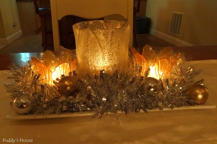New years centerpiece candles tinsel ornaments mercury