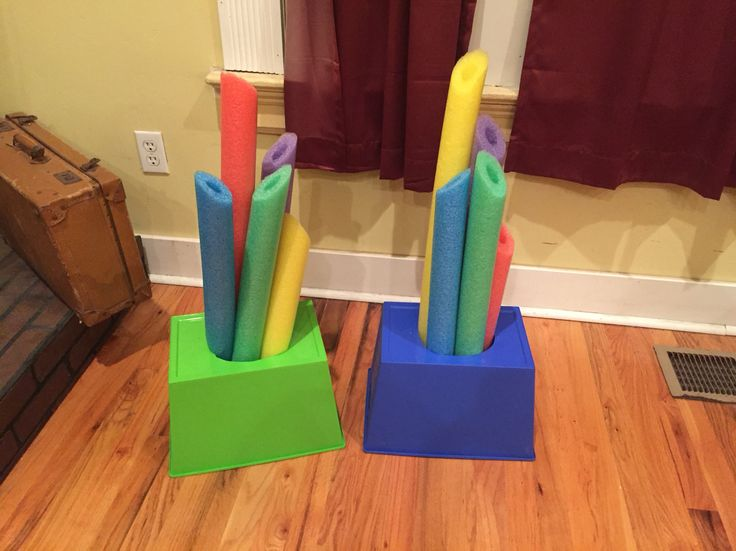 Stalagmites for Cave Quest VBS sign up table. $7.00 all items from the .99 cent store or can be found at the Dollar Store. 5 pool noodle cut in half and two plastic pins to support them.