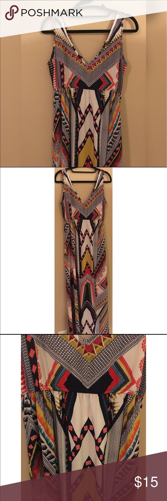"Tribal Aztec Print Maxi Dress Boho Festival Wear-L Long, flowy beautiful Maxi dress with a unique print. Has keyhole closure in the back. Made by Earthbound Trading Company. It is adorable, but it does not fit me. See pictures for chest measurements. Length is approximately 54"". Ref8#oooq Earthbound Trading Company Dresses Maxi"