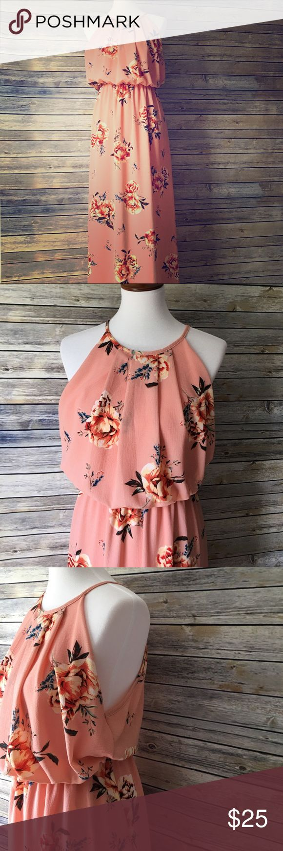 🌺💐FLORAL MAXI DRESS💐🌺 NWOT- This breezy high neck maxi dress is the perfect match for a sunny day. Made of lightweight material with built in slip. Has two splits-one up each side of the dress.  The top is high neck and same as the back with the peep hole by the button. The top is a loose fit and the bottom is flowy. Also has the elastic band around the waist. Dresses Maxi