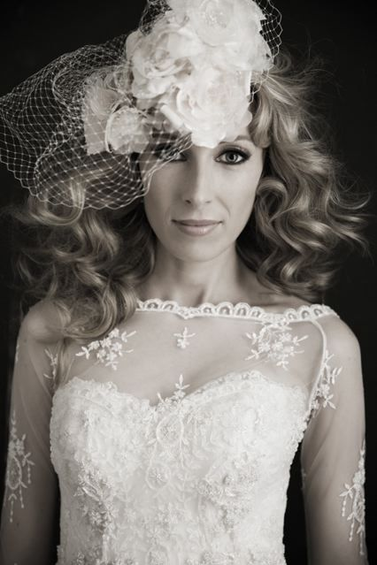 Bridal flower head piece , long sleeve lace wedding gown. Wavy blonde hair with smoky eyes . http://www.gmphotographics.com.au/portrait-couture/