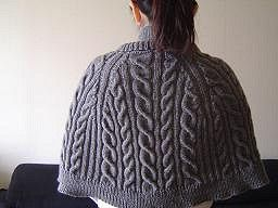 "Pattern Description from Vogue Knitting, Fall 2007: ""Set off on a cape crusade, stitched in Classic Elite Yarns' 100 percent cashmere 'Lavish.' The double-breasted cape is worked with raglan-style shaping in an allover cable rib. Final touches include an overlapping stand-up collar and an interior placket with snaps and button closures."""