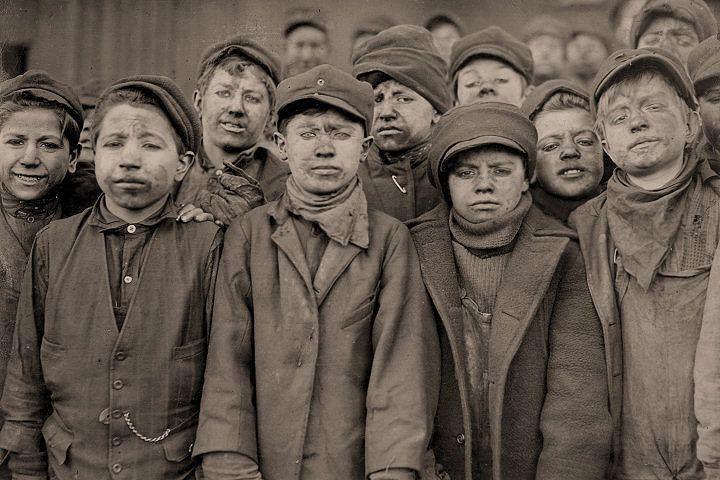 Lewis W Hine. Miners: Breaker boys. Smallest is Angelo Ross. Pittston, Pennsylvania.