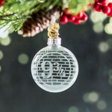 This etched glass ornament is perfect for Harry Potter fans and will match any holiday decor. It is 2.5 inches across with 9 3/4 etched on the front and a brick wall pattern left clear on the etched b