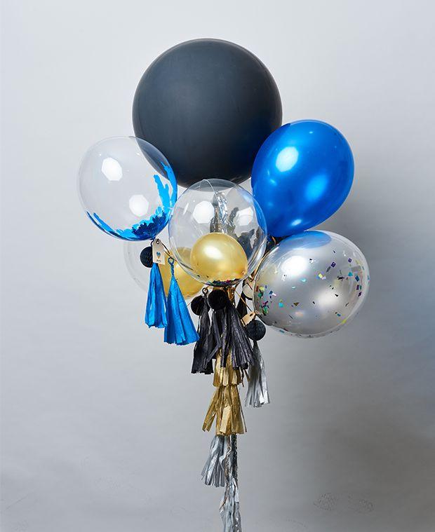 Diseño de 7 globos de diferentes tamaños. ¡Personaliza el globo gigante color negro!