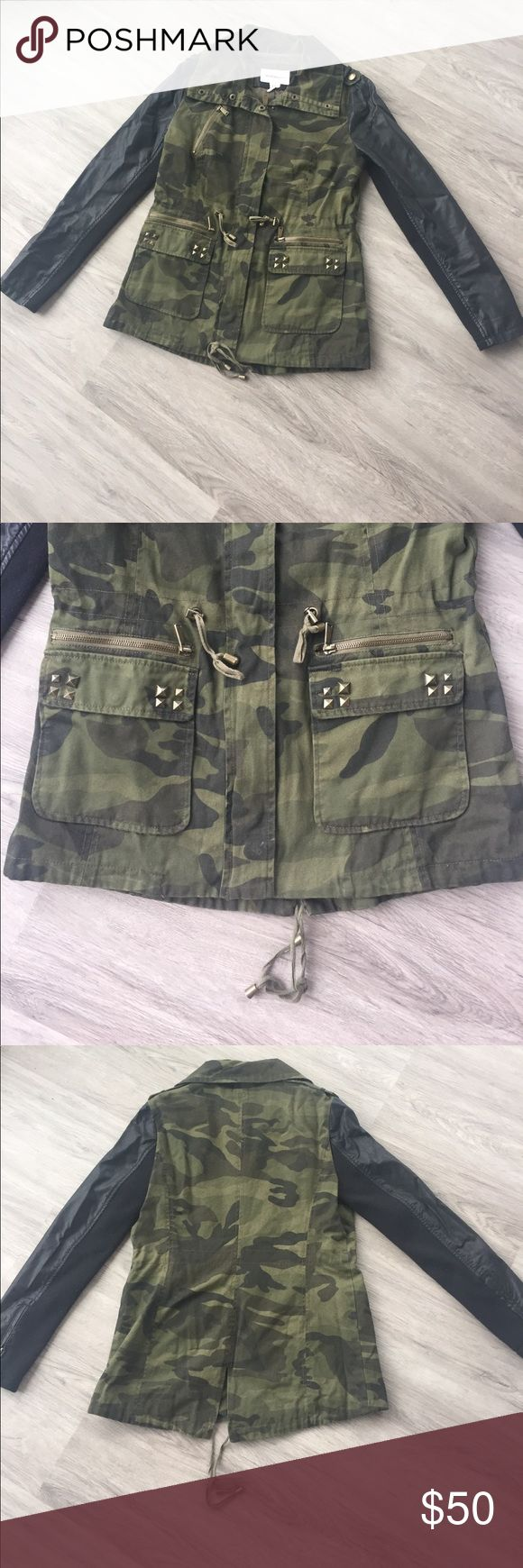 BCBGgeneration camo jacket SIZE: M // COLOR: camo // NAME: BG320220AN // FABRICATION: 100% cotton // NOTES FROM SELLER: cotton shell with faux leather sleeves. Drawstring waist. In good condition. BCBGeneration Jackets & Coats Utility Jackets