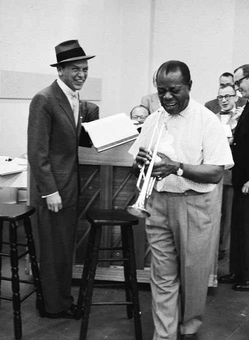 Frank Sinatra and Louis Armstrong laugh it up during rehearsal for The Edsel Show, 1957