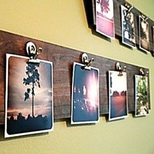 photo display. just stain a wooden board and add clips, would work great for displaying kids' art and looks nice!