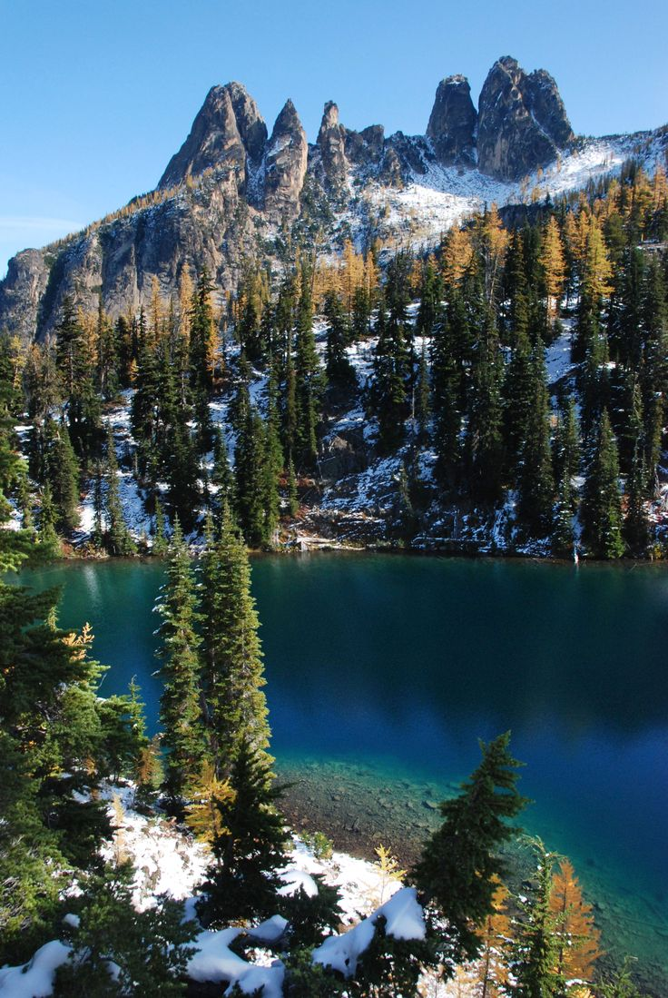 On the back side of Liberty Bell and Early Winters Spires, Blue Lake is a popular destination, easily accessible because of the North Cascades Highway. Visitors respect for the area shows as it remains pristine. This basin and the surrounding peaks are National Forest land so are not protected as part of the National Park. Photo by Jack McLeod. http://www.washington.edu/uwpress/search/books/MCLNOR.html