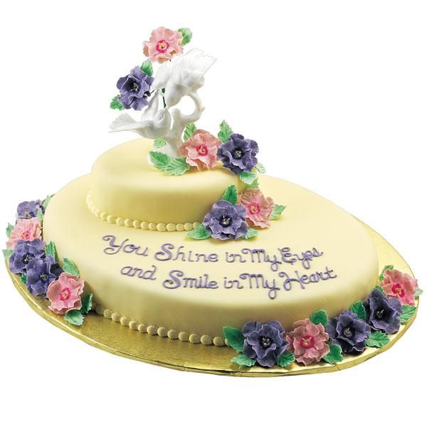 Paradise Together Cake -- Stack Oval Pan cakes to create an interesting shape. Promote romance by piling on gum paste flowers formed with our Step-Saving Rose Bouquet Flower Cutter Set and readymade Yellow Stamens.