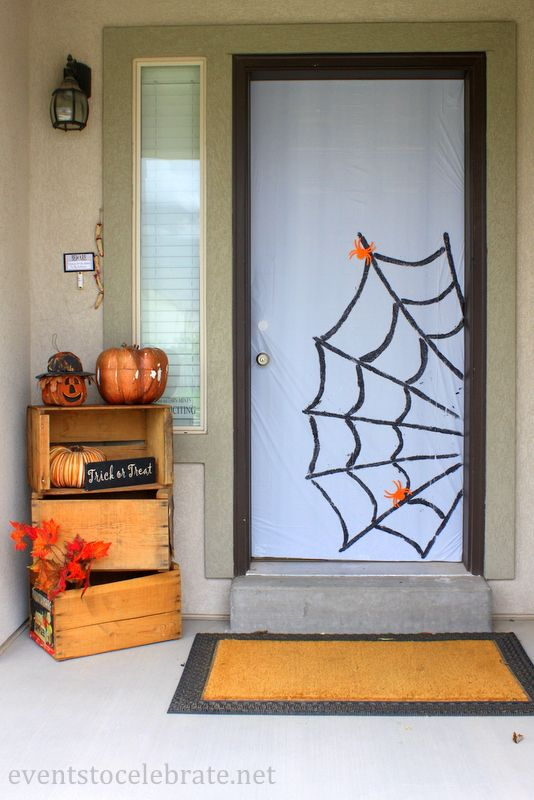 Easy Halloween Door Decoration - Events To Celebrate  -- LOVE the crates.  I want some for my front porch