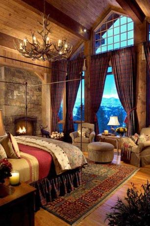 Rustic Master Bedroom with picture window, stone fireplace, ANTIQUE HEART PINE RECLAIMED WOOD PANELING, Hardwood floors