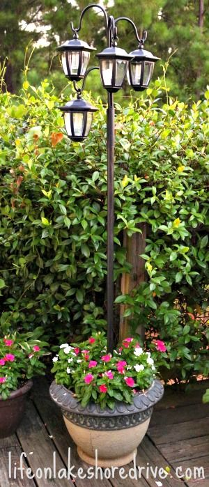 DIY Solar Light Lamp Post with Flower Planter Life on Lakeshore Drive. I like this idea for the front of house to light up walk way