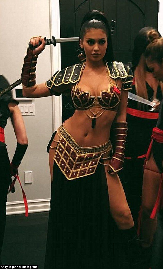 Kylie Jenner shows off her cleavage and toned tummy in Halloween Xena costume | Daily Mail Online