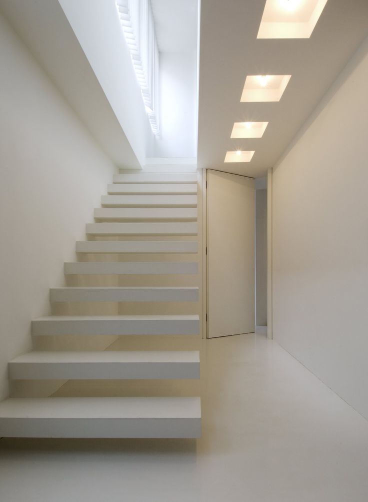 Open tread stairs and full height door in mews house by Andy Martin  Architects, London